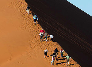 Walking up the sand dune - Diverse Namibia